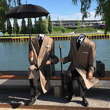 Headless men as walking acts at Autostadt Wolfsburg